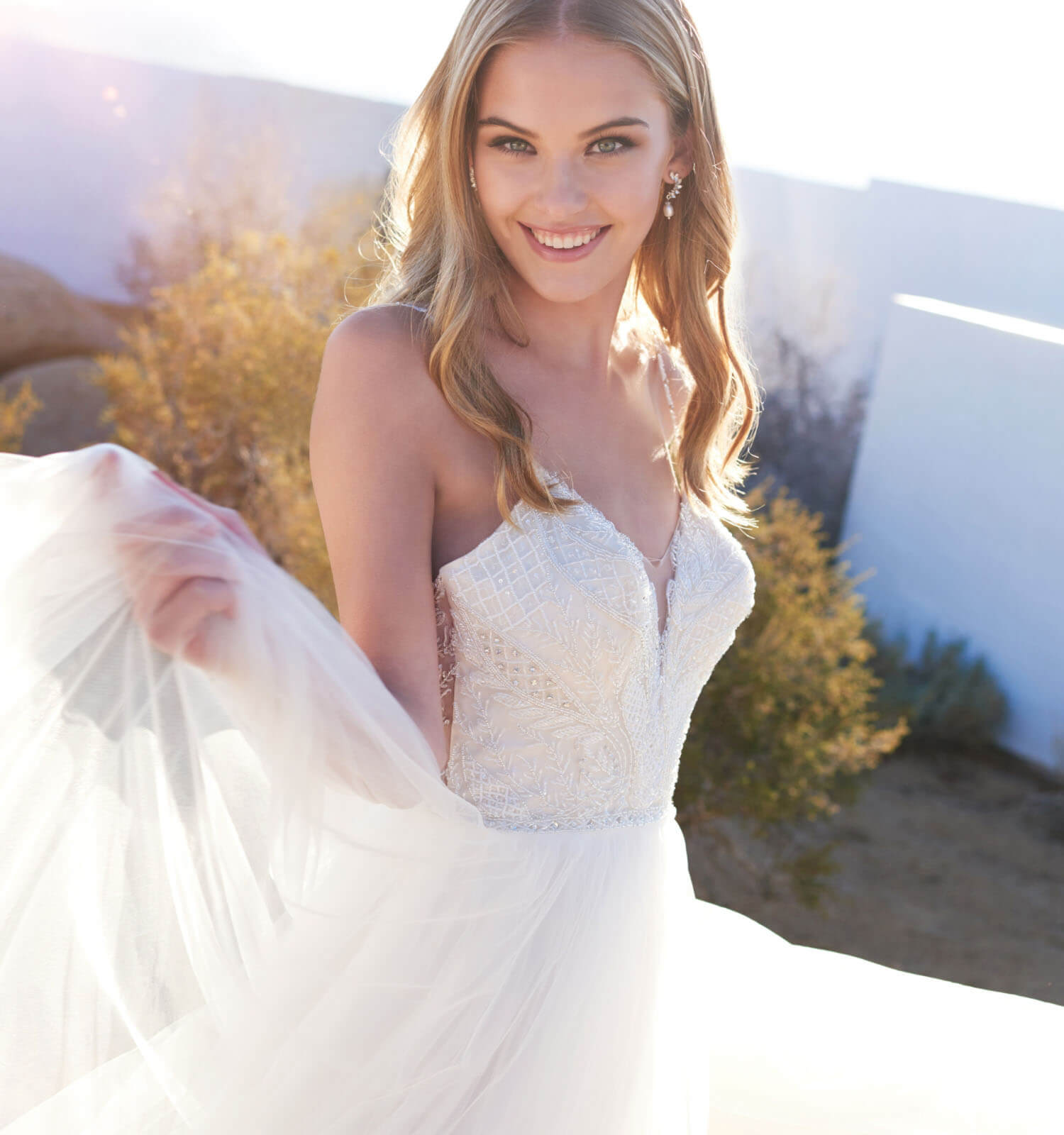 Blonde bride in white wedding dress. Mobile Image